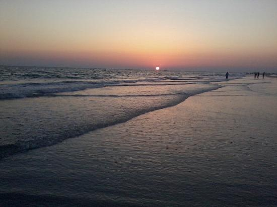 Treasure Island, FL: walking on the beach at sunset
