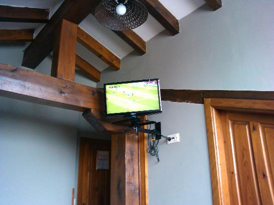 La posada de Somo : Tele y techos con vigas de madera