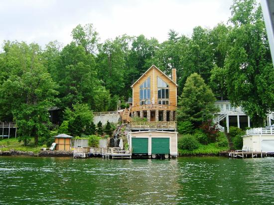 Lake Lure Tours : lake lure house with man-made waterfall (next to boat house)