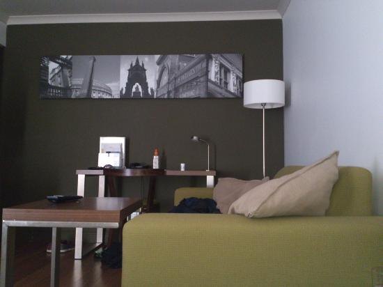 Citadines South Kensington: View of sofa and desk from bed.