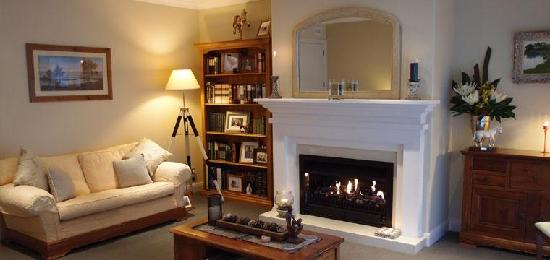 Otesha Falls: Guests have access to their own sitting room where you can relax by the fire.