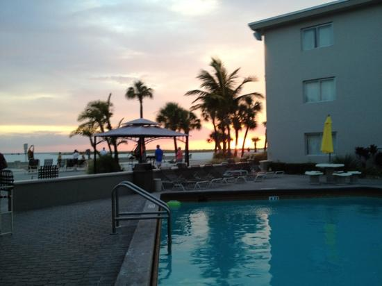 Thunderbird Beach Resort: view of the beach from the pool at sunset