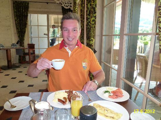 ERMITAGE Wellness- & Spa-Hotel: ENJOYING BREAKFAST IN L'ORANGERIE IN RENOVATED WELLNESS & SPA HOTEL ERMITAGE.