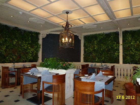 VIEW OF RESTAURANT L'ORANGERIE IN RENOVATED WELLNESS & SPA HOTEL ERMITAGE.