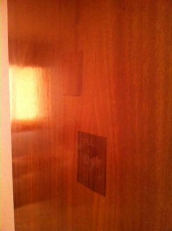Marc Apartments: doors been punched in previously