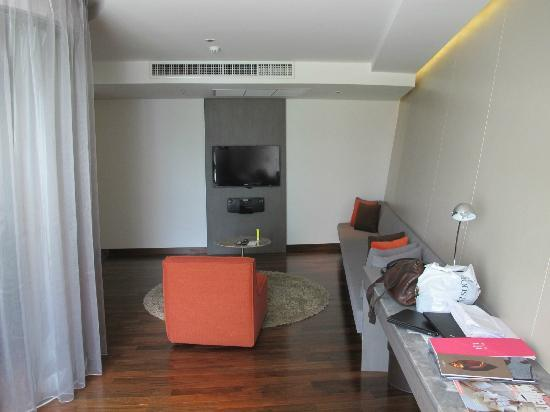 LiT BANGKOK Hotel: Full Spectrum Suite - small tv and sofa that is too narrow to sit n