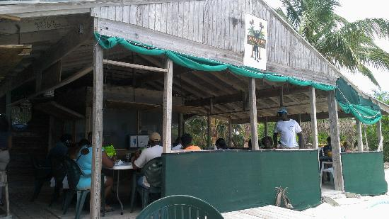 Bahama John's Seafood-N-Rib Shack: Back...that's HJohn Munroe the owner/chef in the white t-shirt
