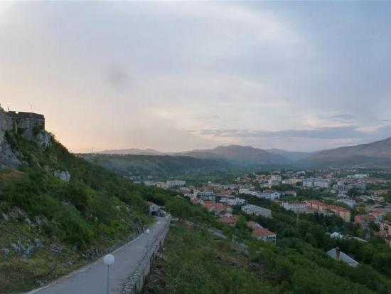 Knin Fortress: Town at sunset driving out