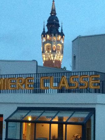 Premiere Classe Calais Centre - Gare : Hotel at dusk with bell tower behind