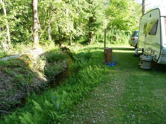 Montloue: Caravan Pitch by Stream