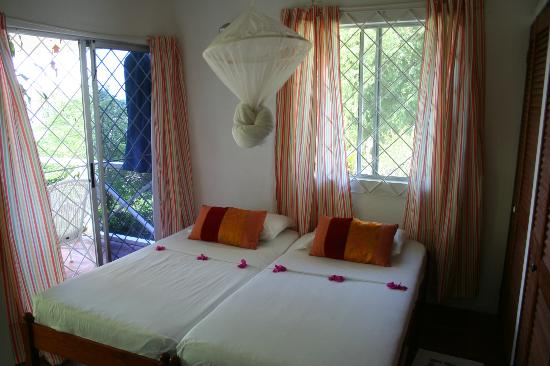 The Village Apartments: Our bedroom - airy, lots of light. Veranda & living room to the left, closet and bathroom on ri