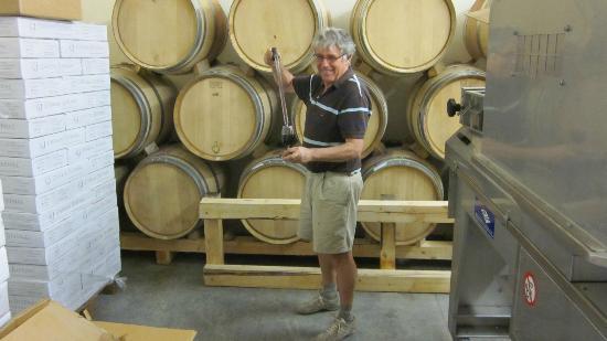 Bernard drawing a barrel sample at Chateau Juvenal's new winery