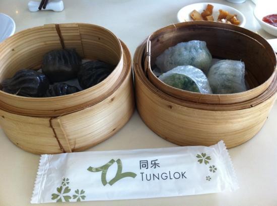 Tung Lok Signatures: black truffle dumplings and century egg spinach dumplings