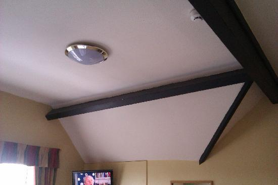 "The Portland Hotel: Attractive ""cottage-style"" ceilings in some top-floor rooms."