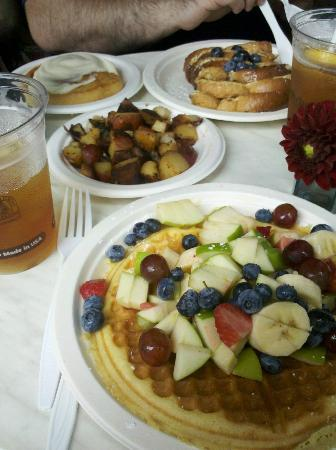 Among The Flowers Cafe: Belgium Waffle with fresh fruit, hash browns, Cinnamon roll and French Toast