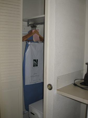 Quality Inn & Suites Chambersburg: A tiny closet between the room door and small shelf for a coffee make