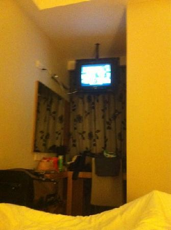 Crown Garden Hotel: the so called flat screen hanging from a hole in the ceiling