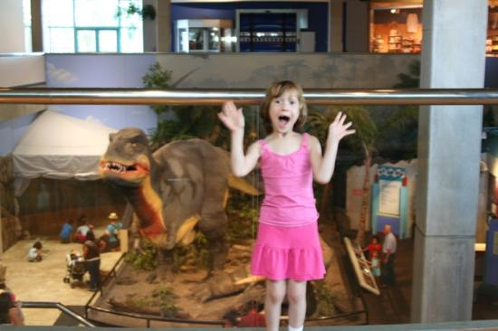 Saint Louis Science Center: My daughter screams in terror as the science center's T-rex sneaks up behind her.