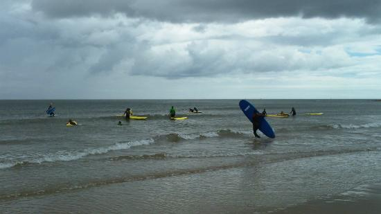 Surfing on Long Sands Beach.