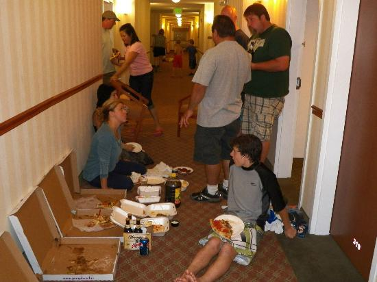 Quality Inn & Suites Hershey: 5 familys sharing pizza in the 3rd floor hallway.