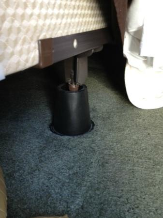 Crowne Pointe Historic Inn & Spa: The plastic cones that held up our queen-sized bed in our $459 per night room.