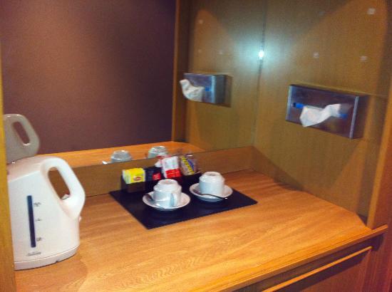 Sundowner Jika International: Basic Kitchen area- with small fridge underneath (with sachet of milk & other items)