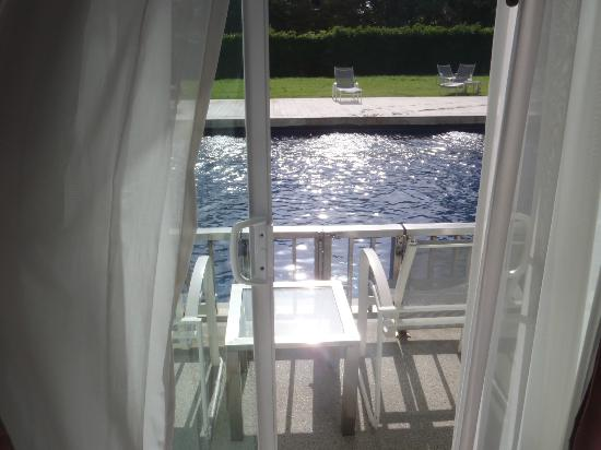 Sugar Marina Resort - ART: Pool Access balcony with glaring noonday