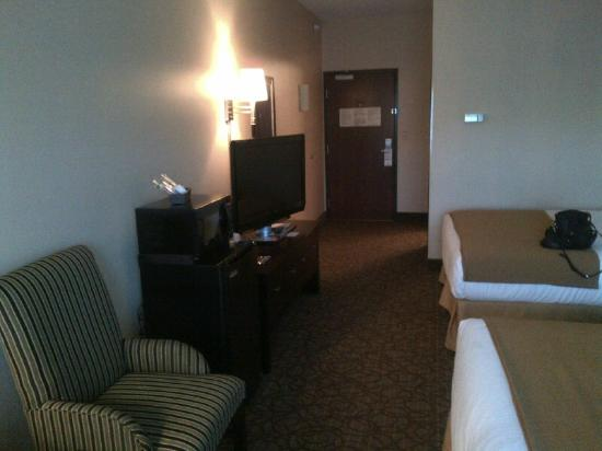 Holiday Inn Express Hotel & Suites Concordia US 81 : Double Queen Room with fridge, flat screen tv, and microwave
