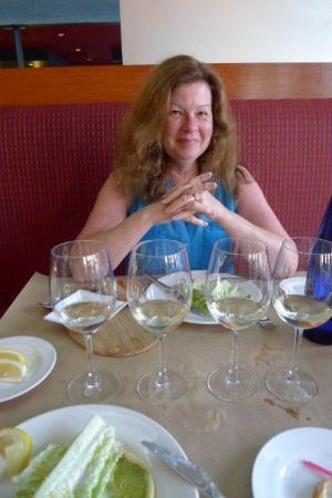 Cafe Pierre: Sparkling water, salads, and white wine tasting to begin meal