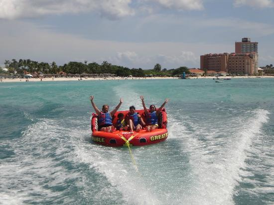 "Fun 4 Every 1 Watersports Aruba : Guests enjoying the tube ride on the Great Big Mable (AKA ""the Big Comfy Couch"")"