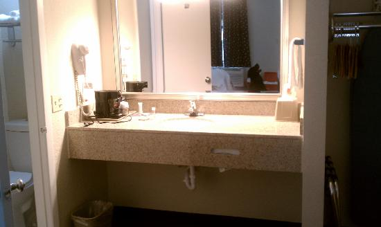 Super 8 Paducah KY : Vanity outside bathroom with hairdryer and coffeemaker