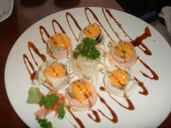 TORO Sushi : Voodoo Roll (Eel, Tuna, Avacado wrap with red snapper and salmon.  Baked spicy mayo and eel sauc