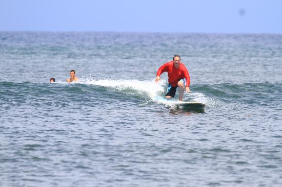 Blue Rush Surf School: Attempting to stand on the first try and did!