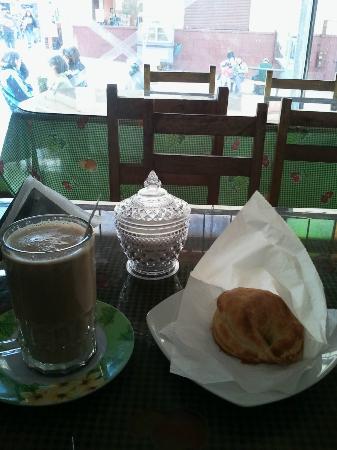 Chicharroneria Cuzco: Chicker Empanada and Hot Chocolate