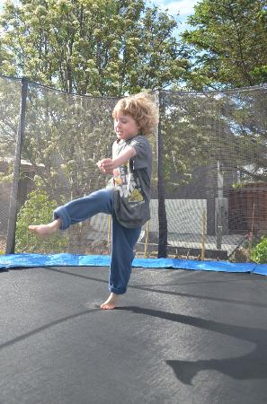 Blue House: my son having a blast on the trampoline