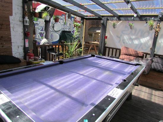 Vagabonds: Outside courtyard/pool table