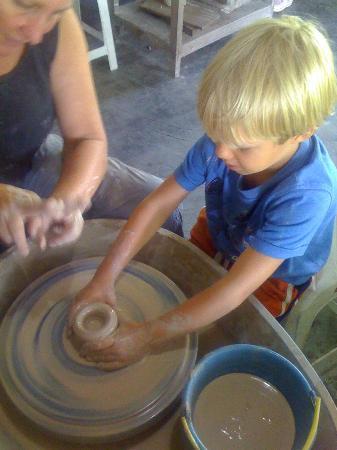 My little guy on the wheel at Sari Api Ceramic Studio!