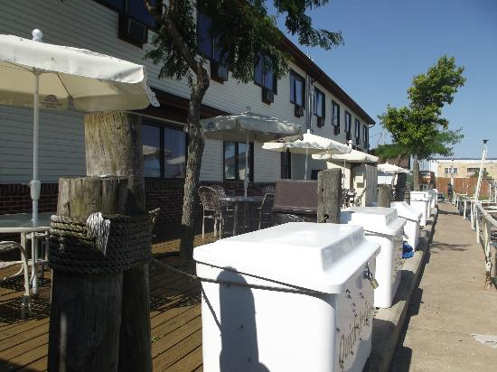Arlington Inn: The deck in back of the hotel, White coolers are for fish caught by people docking boats here.