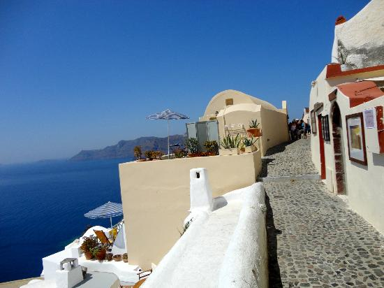 Old Oia Houses: The balcony and umbrella (top one) is the studio, another family house is below