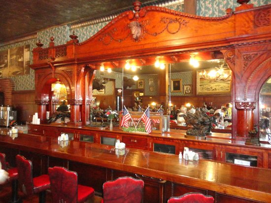 Irma Restaurant and Grille: The wood antique wood bar in the restaurant