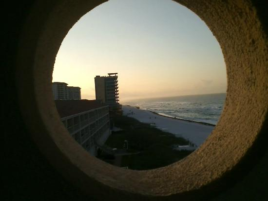 Destin Gulfgate: View out viewing hole on balcony looking east at sunrise. Only corner rooms feature this!