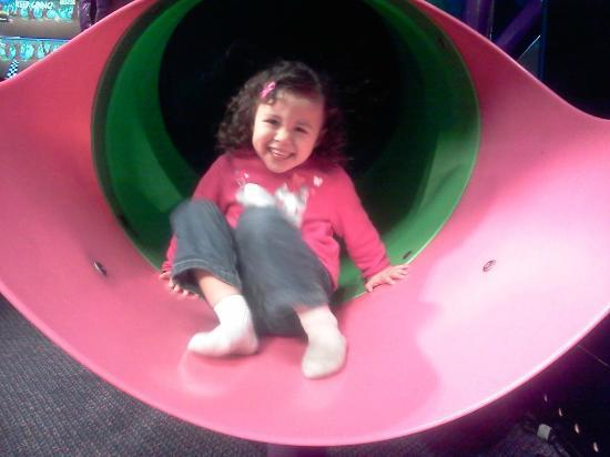 Chuck E. Cheese's: my daughter going down the slide