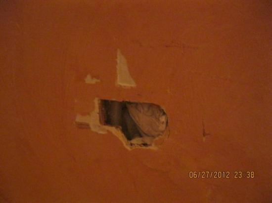 Hotel de Lille- louvre: Hole in the wall with something shoved inside