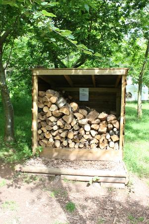 Woodland Tipis and Yurts: Wood store for campfires and the log burners in the yurts