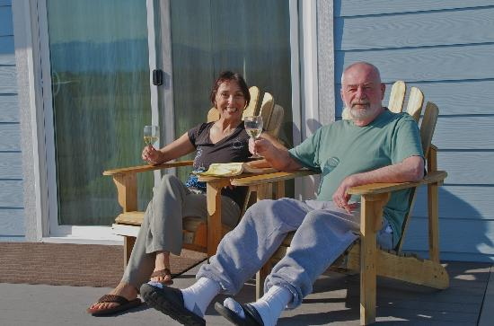 Juan de Fuca Cottages: Enjoying an afternoon on the porch of our cottage with mountain, sea and pasture views!