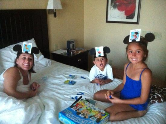 West Inn & Suites Carlsbad: The DEHARO family playing a game in the king suite . June 27,2012
