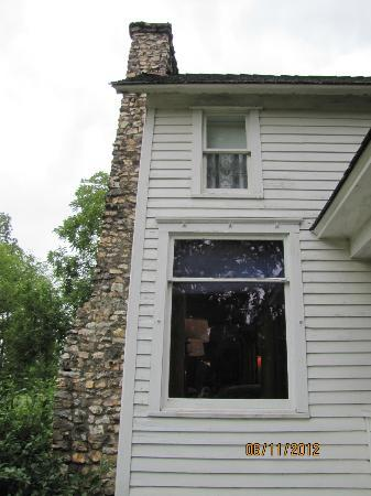 Mansfield, MO: Curtains drape the mysterious upstairs window