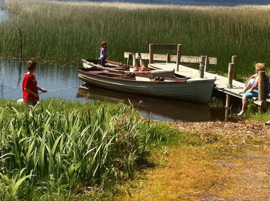 Riverhaven Log Cabins: sitting on the dock of the bay