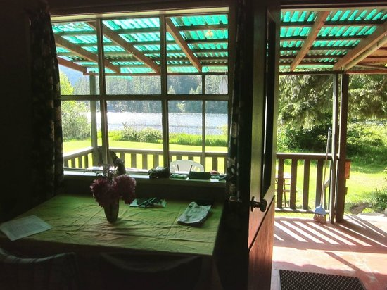 Whispering Falls Resort: view from cabin #1. All cabins have views of the lake+surrounding mountains, to varying degrees