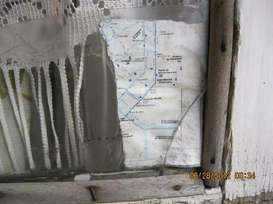 Hotel de Lille- louvre: Window repaired with metro map and tape - ingenius!